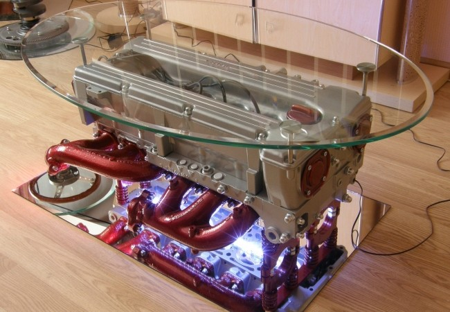 Coffee table made from Mercedes-Benz engine with round glass top